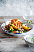 Aloo Bombay, potato and carrot curry with spinach and wild rice