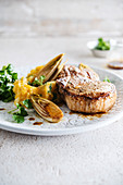 Pork chops, orange-flavored mashed potatoes and braised chicory