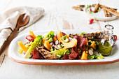 Sucrine lettuce, melon, radish, toasted bread and bresaola