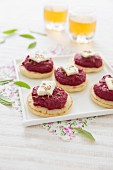 Creamed beetroot and goat's cheese blinis