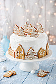 Village under the snow Christmas cake