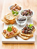 Tuna Tartare With Golden And Black Sesame Seeds On Tuc Aperitif Crackers