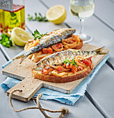 Grilled Sardines With Salt,Spices And White Wine,Stewed Onions And Tomatoes On Toast