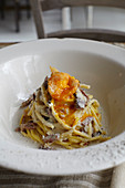 Spaghettis carbonara and soft-boiled egg croquette