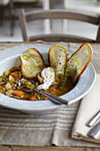 Minestrone with a poached egg and thin slices of bread
