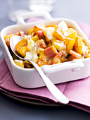 Mixed peaches in creamy sauce