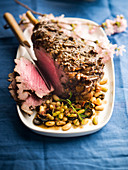 Leg of lamb with flageolets beans and black olives