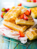 Brussels waffles with icing sugar and strawberries