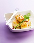 Roasted scallops with fresh herb and pink pepper butter