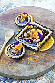 Dark chocolate, almond, pansy and orange tartlets