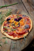 Tomato, cheddar, rosemary and pansy pizza