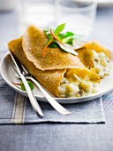 Scallop and mushroom galettes, white wine sauce