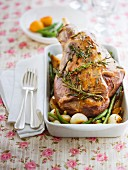 Leg of lamb roasted with herbs, green beans and onions