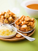 Grated cheese and croutons for fish soup