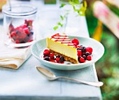 Slice of cheesecake with summer fruit coulis