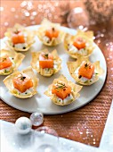 Diced smoked salmon, lime and pink pepper whipped cream in a filo pastry nest