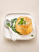 Carrot and crab mousse flan, parsley sauce