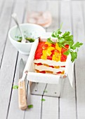 Fromage frais and red and yellow pepper terrine, parsley vinaigrette