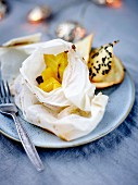 Spicy mango and star fruit papillote, black sesame seed tuiles