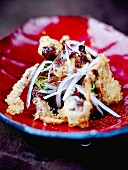 Spicy and crispy octopus fritters with red onions