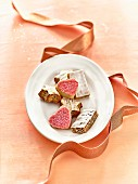 Plate of mixed Christmas biscuits and ribbon