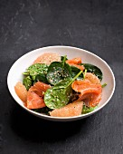 Baby spinach, smoked salmon salad with sesame seeds