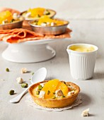 Lemon curd, orange segment, crushed pistachio and nougat tartlet