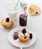 White chocolate muffins, red fruit coulis