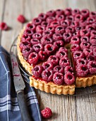 Raspberry tart with red fruit coulis
