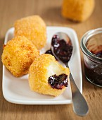 Fried cheese balls with black cherry jam