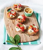 Creamed pepper, mozzarella and mixed tomato-strawberry crostinis with mint