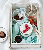 Basket-crate with verrines ;blancmange with raspberries, chocolate ganache with chocolate biscuit crumbs, strawberry syrup