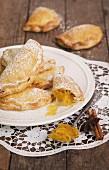 Aniseed turnovers garnished with pumpkin angel hair jam