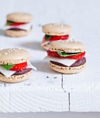 Dark chocolate ganache, white almond paste, strawberry and basil burger-style Macarons