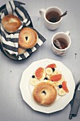 Cinnamon-flavored cream cheese bagel and banana, grapefruit and blueberry salad