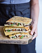 Black tapenade, marinate artichoke, sun-dried tomato, rocket lettuce and parmesan focaccia sandwiches