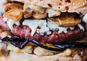 Close-up of a beef, aubergine, Roquefort and button mushroom hamburger