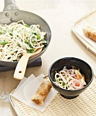 Sauté noodle, coriander, red onion and grated carrot bo-bun with nems