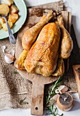 Roasted chicken with thyme, rosemary, garlic and baked potatoes