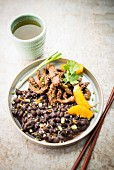 Beef sauté with sesame, black beans and orange