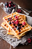 Pile of plain Brussels waffles with red berry coulis