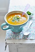 Bowl of pumpkin soup with fresh coriander
