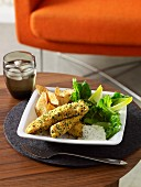 Baked fish fingers with herb crust, aioli and potato wedges