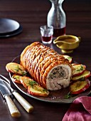 Roasted pork breast stuffed with spinach, breadcrumbs and apples