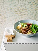 Japanese noodle soup with pork and egg