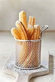 Churros with icing sugar