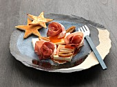 Cream cheese, raw ham and date terrine with date syrup, star toasts