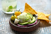 Cod ceviche with mild green pepper emulsion, avocado, striped aubergine and yellow cherry tomatoes, tortillas