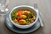 Rice sauté with tomatoes, red and green peppers and curried potatoes