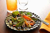 Baby beetroot shoots, squid and spring carrot salad